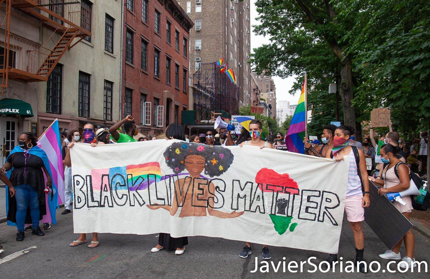 """Thursday, July 30, 2020. Manhattan, New York City - Rally and March: """"Liberation for Black Queer and Trans people."""" Protesters had a rally in front of The Stonewall Inn. After the rally, they marched to Foley Square Park. A Trans woman said sometimes Trans women and Trans men are killed by police and sometimes they are killed by their own community. Activists said all Black Lives Matter. Joel rivera said, the rally and march was to honor and acknowledge Black Queer and Trans people. Photo by Javier Soriano/www.JavierSoriano.com"""