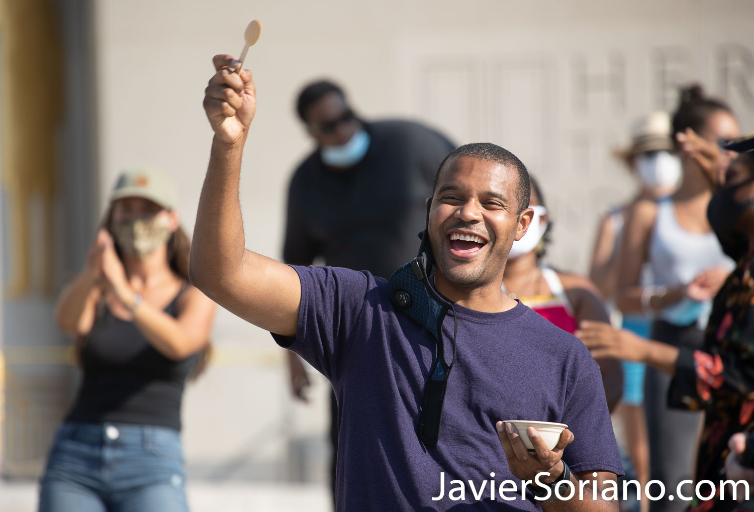 """Sunday, September 6, 2020. Brooklyn, New York City - """"Community Carnival"""" at Grand Army Plaza in Brooklyn. Jabari Brisport was one of the speakers today. Jabari Brisport will be the next New York State senator in District 25. Jabari Brisport will be the first openly gay Black New York state Senator. In this photo, Jabari is dancing, enjoying some ice cream and having a good time. The Wide Awakes and Large Up said: """"We celebrate and honor the beauty and brilliance of Caribbean culture. As many of you all know, due to COVID-19, the annual West Indian Day parade is going virtual this year. With love and in solidarity, The Wide Awakes and Large Up are excited to amplify the voices of our Caribbean brothers and sisters with a fun filled day of unity and empowerment."""" Photo by Javier Soriano/www.JavierSoriano.com"""