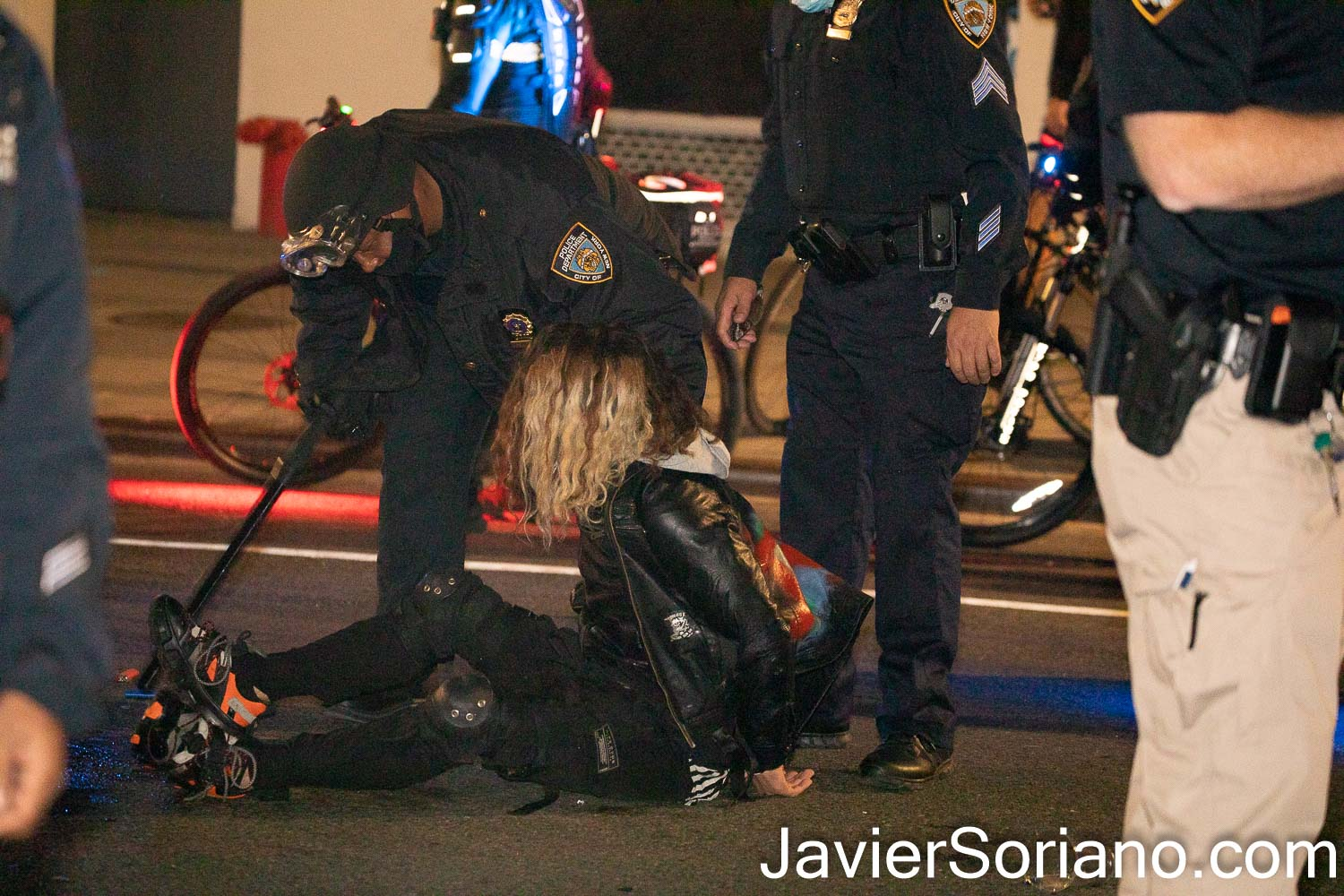 """Thursday, November 5, 2020. Manhattan, New York City – Rally and march """"WE CHOOSE FREEDOM."""" Trans rights activists demand respect for Black Trans women and Black Trans men. NYPD officers arresting a white man. Photo by Javier Soriano/www.JavierSoriano.com"""