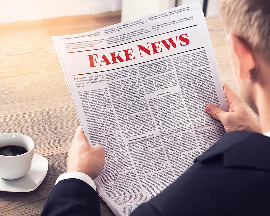 Person Reading Fake News Article.  Photo by Mike MacKenzie/Wikipedia.org