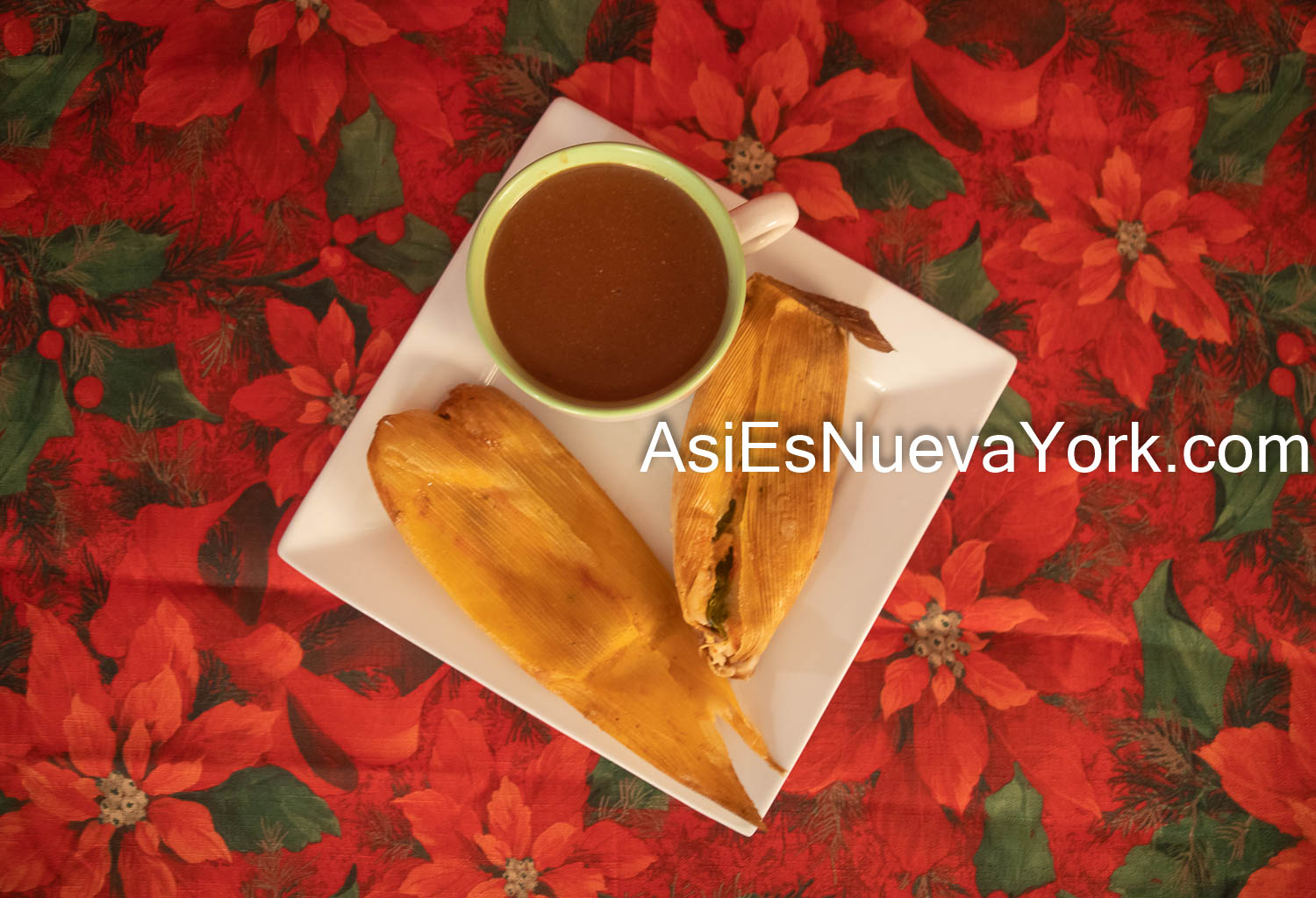 Wednesday, December 9, 2020. Brooklyn, New York City – Delicious tamales and champurrado. The background is a Cuetlaxóchitls tablecloth. The Cuetlaxóchitl is a Mexican plant. The Cuetlaxóchitl is also known as Flor de Nochebuena, poinsettia flower, etc. Photo by Javier Soriano/www.JavierSoriano.com