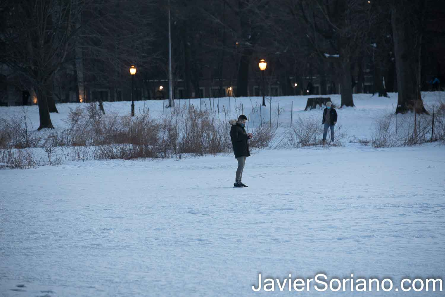Sunday, February 21, 2021. Brooklyn, New York City – Man walking on a frozen lake in Prospect Park. Photo by Javier Soriano/www.JavierSoriano.com
