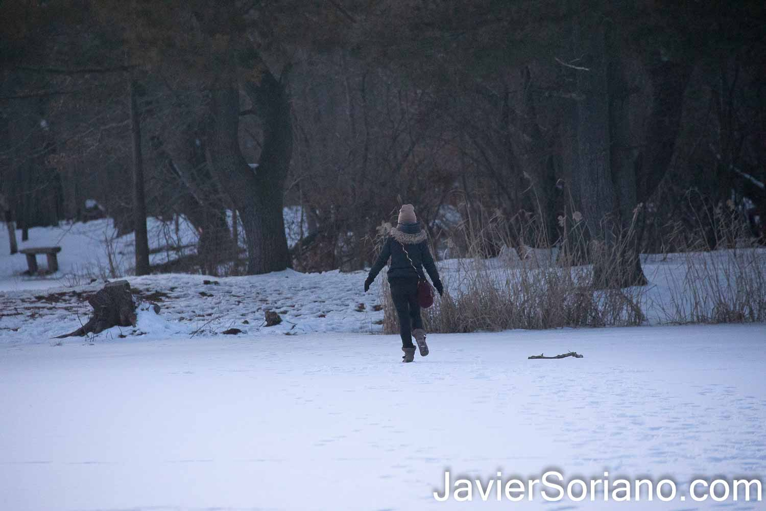 Sunday, February 21, 2021. Brooklyn, New York City – Woman walking on a frozen lake in Prospect Park. Photo by Javier Soriano/www.JavierSoriano.com