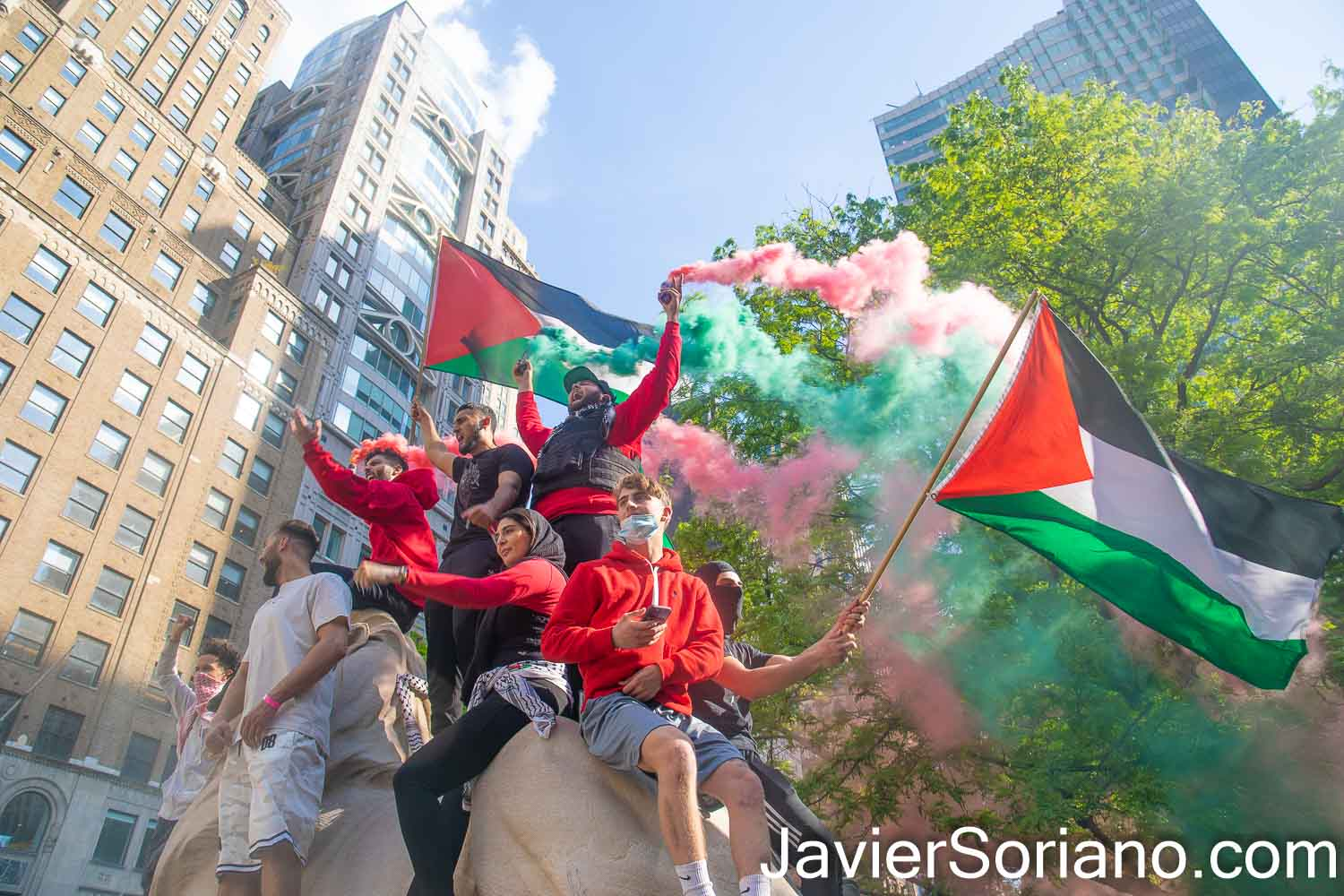 """Tuesday, May 18, 2021. New York City - Thousands of Palestinians, Jews, Latinas, Latinos, Asians, Blacks, Whites, and others shut down different streets in New York City to support the Palestine Strike. BDS said, """"Palestinians in Jerusalem and across Historic Palestine are observing General Strike (on Tuesday, May 18, 2021) to protest Israel's massacres in Gaza and settler-colonial and apartheid repression and ethnic cleansing against Palestinian communities everywhere."""" People gathered in front of the zionist (Israel) mission to the United Nations. After the rally, demonstrators marched through different streets in Manhattan. Organizers called the demonstration: """"Shut down Zionism to support the #PalestineStrike."""" The demonstration was organized by NY4Palestine, Al-Awda NY: The Palestine Right to Return Coalition, Samidoun Palestinian Prisoner Solidarity Network, Within our Lifetime • United for Palestine, Jews for Palestinian Right of Return and Labor for Palestine. THIS PHOTO: Demonstrators in front of the New York Public Library (188 Madison Avenue and 34th Street). Photo by Javier Soriano/www.JavierSoriano.com"""
