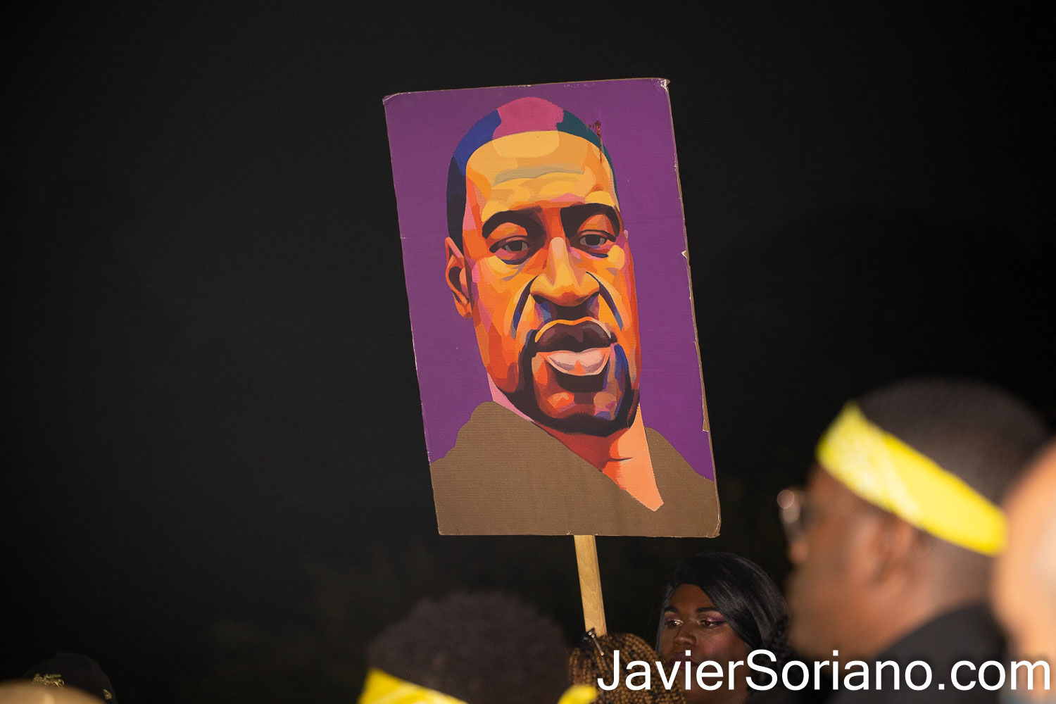 Tuesday, May 25, 2021. Brooklyn, New York City - On the one year anniversary of the murder of George Floyd, some people held a remembrance vigil at the Brooklyn Museum. THIS PHOTO: Trans woman Qween Andy Jean holding a painting of George Floyd. Photo by Javier Soriano/www.JavierSoriano.com