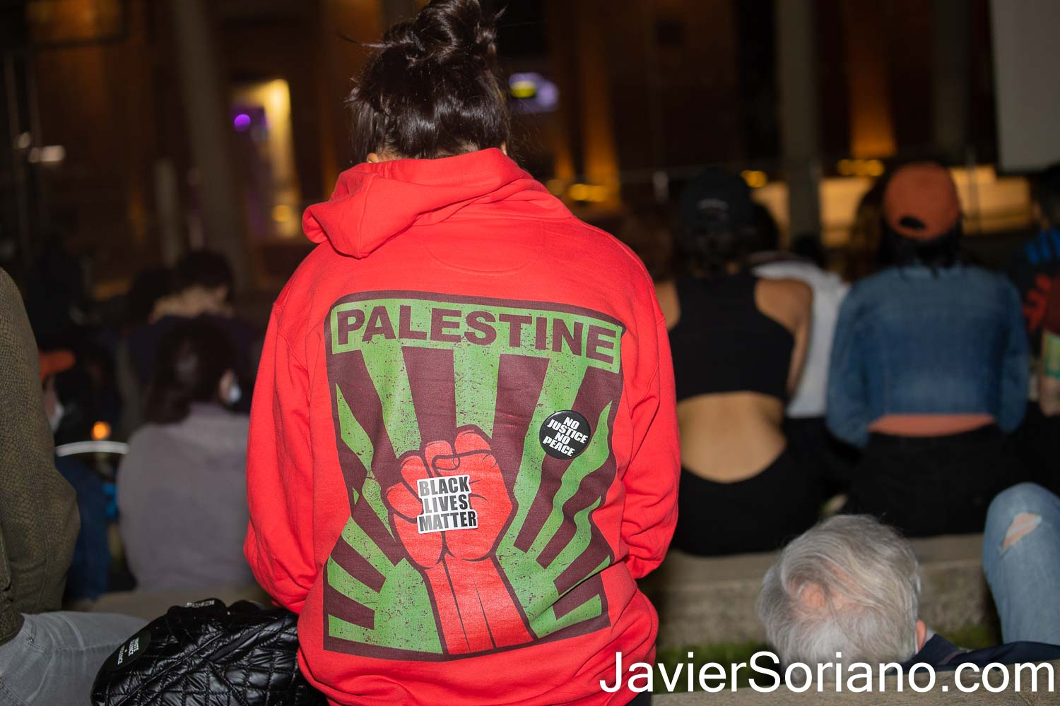Tuesday, May 25, 2021. Brooklyn, New York City - On the one year anniversary of the murder of George Floyd, some people held a remembrance vigil at the Brooklyn Museum.  THIS PHOTO: Woman wearing a PALESTINE / Black Lives Matter sweater hoodie.  Photo by Javier Soriano/www.JavierSoriano.com