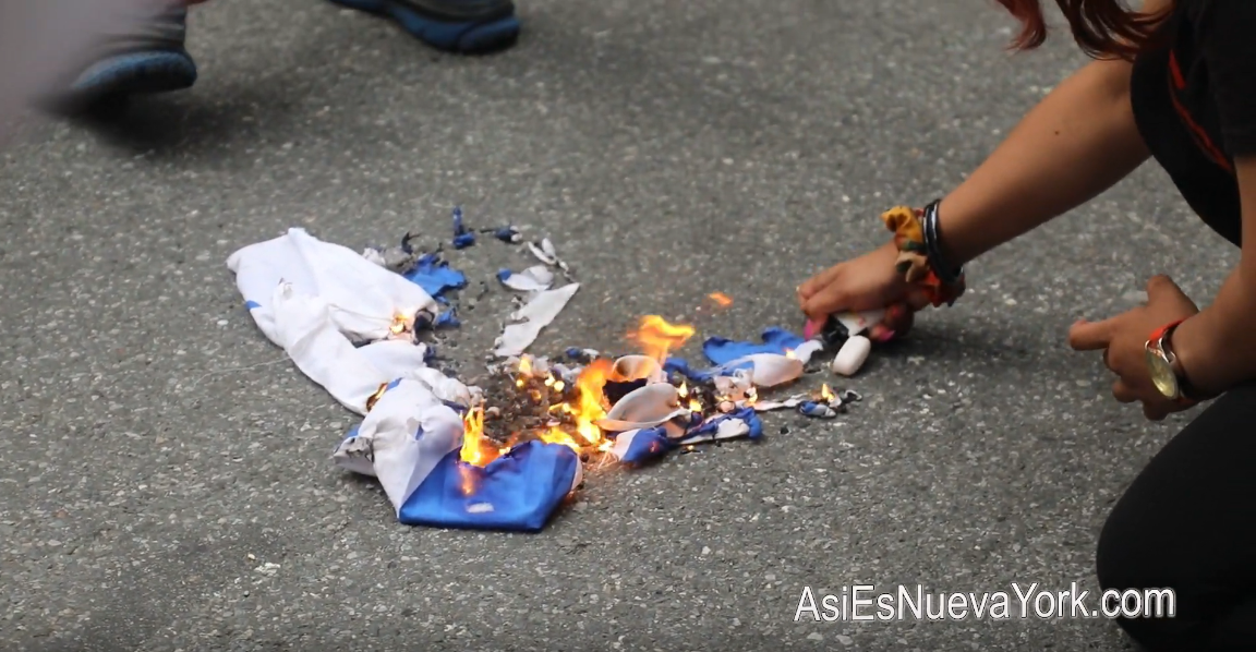 Friday, June 11, 2021. New YorkCity - Palestinians and their allies burning a zionist (Israel) flag in front of the Rockefeller Center in Manhattan, NYC.