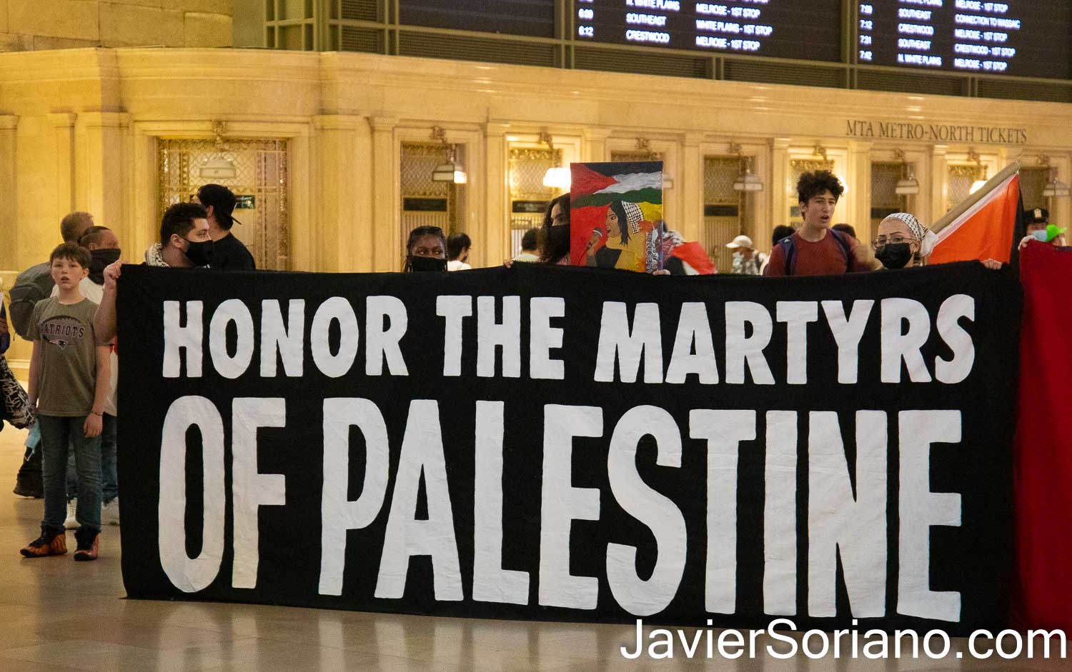 """Sunday, August 29, 2021. Manhattan, New York City – The organization Within Our Lifetime (WOL) held a demonstration inside the Grand Central Terminal. After the rally, they marched to the Israeli consulate in the same borough of Manhattan, in New York City. WOL called the demonstration: """"FREE OUR MARTYRS: DIE-IN & SPEAK OUT FOR PALESTINE."""" Protesters demanded """"the return of Palestinian martyrs bodies who are being held hostage by the Zionist (Israel) entity."""" Photo by Javier Soriano/www.JavierSoriano.com"""