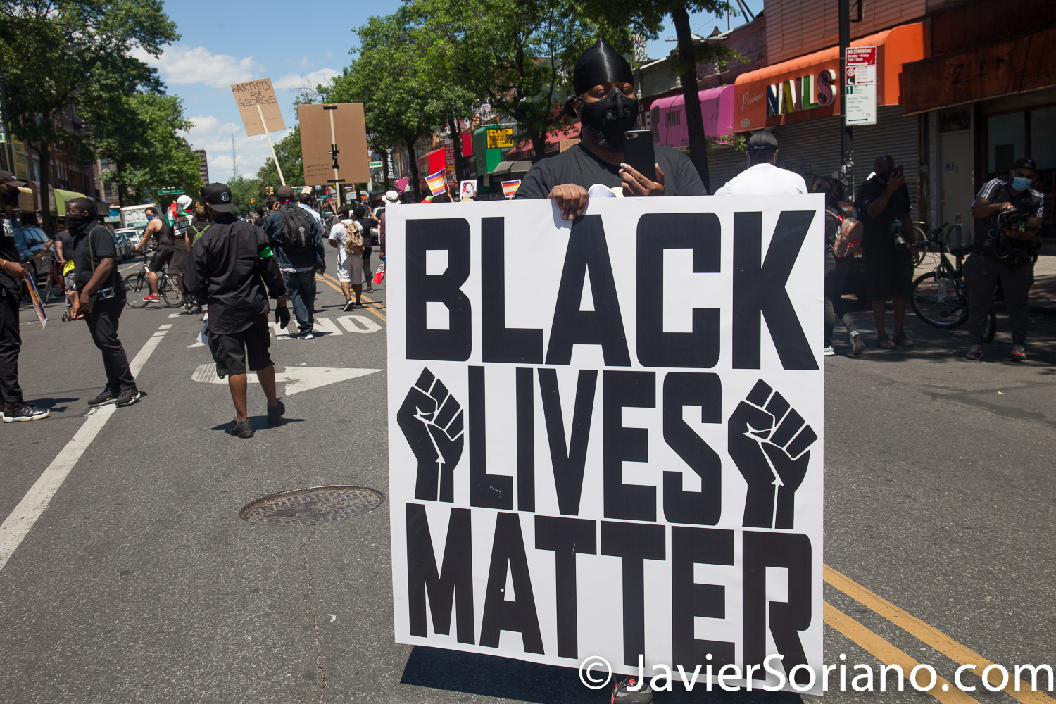 Sunday, June 14, 2020. Brooklyn, New York City – Caribbean Americans gathered on Flatbush Ave and Church Ave in Flatbush and marched to Grand Army Plaza for a rally. Protestors demanded justice for George Floyd, Breonna Taylor and the many other people killed by police officers in the United States of America. They also demanded that Council members and NYC Mayor Bill de Blasio cut the NYPD budget by at least one billion. Photo by Javier Soriano/www.JavierSoriano.com